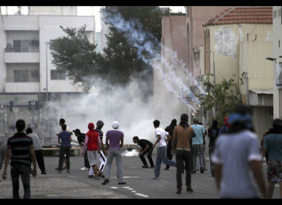 Tear gas rains down on anti-government protesters Tuesday, Nov. 22, 2011, in Sitra, Bahrain, where clashes erupted during a p