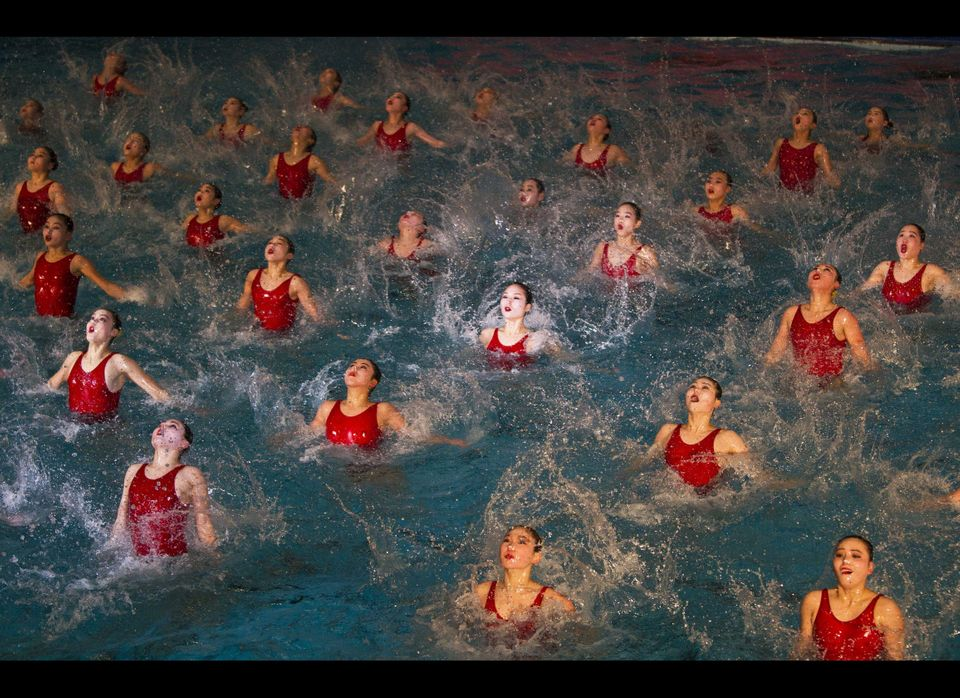 North Korean women perform in a mass synchronized swimming show in Pyongyang, North Korea Wednesday, Feb. 15, 2012 to celebra