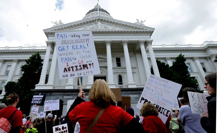 Anti-vaccine protesters demonstrate in front of the California Capitol in 2015, when Sen. Richard Pan's first vaccine law pas