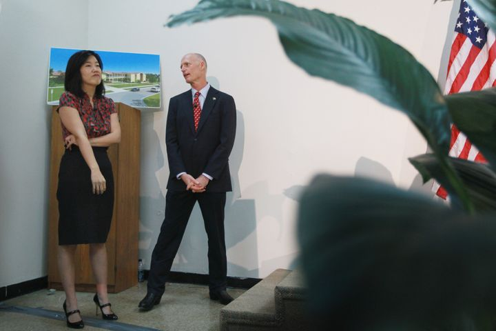 OPA LOCKA, FL - JANUARY 06: Florida Gov. Rick Scott (R) stands with Michelle Rhee, who was named as the Informal Education Ad