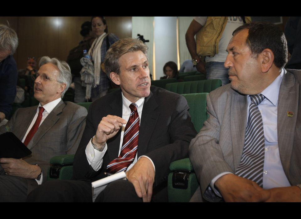 In this photo taken Monday, April 11, 2011, then U.S. envoy Chris Stevens, center, accompanied by British envoy Christopher P