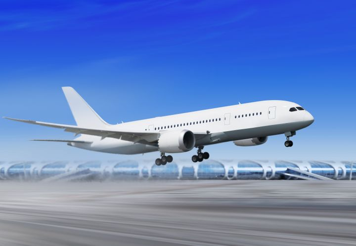 white passenger plane is...