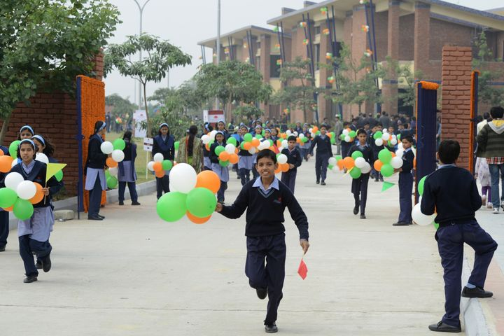 Schoolchildren hold balloons while on campus at the Vidyagyan Leadership Academy in Bulandshahr on December 16,2012. The stat