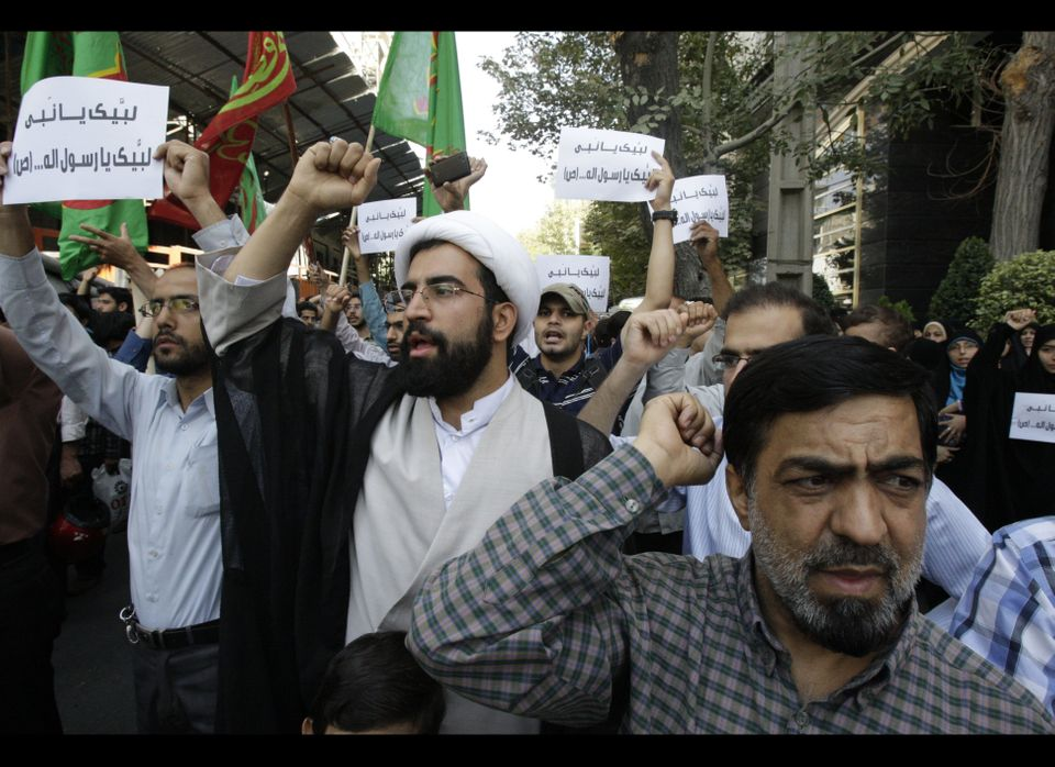 Iranian protestors chant slogans during a demonstration against a film ridiculing Islam's Prophet Muhammad, in front of the S