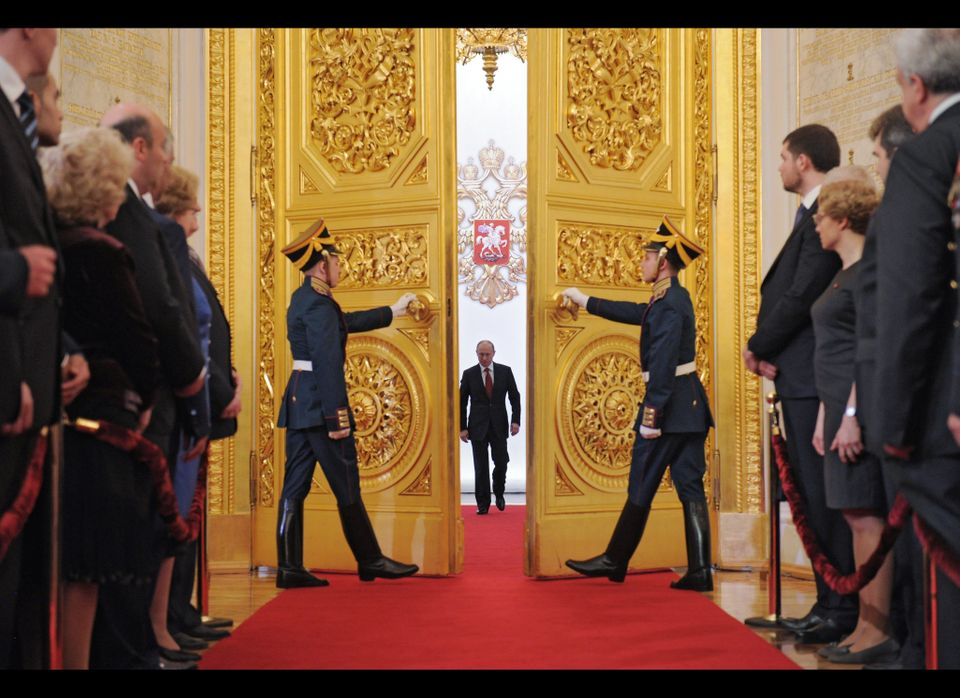 Russia's President Vladimir Putin (C) enters Andreyevsky (St.Andrew's ) Hall at the Great Kremlin Palace in Moscow's Kremlin,