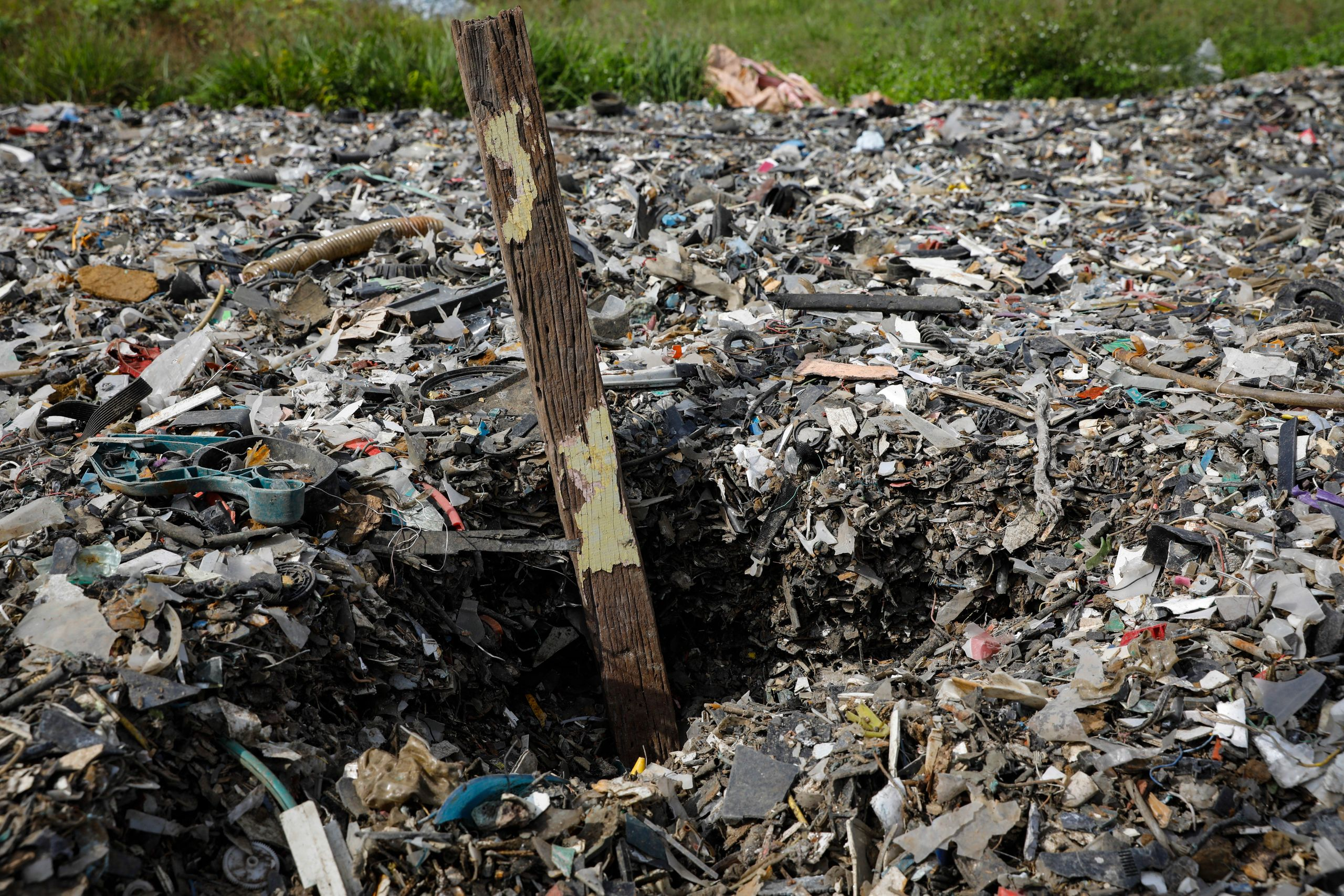 Plastics piles up at an illegal dumping site inside a palm oil estate in Kuala Langat on Feb. 2, 2019.