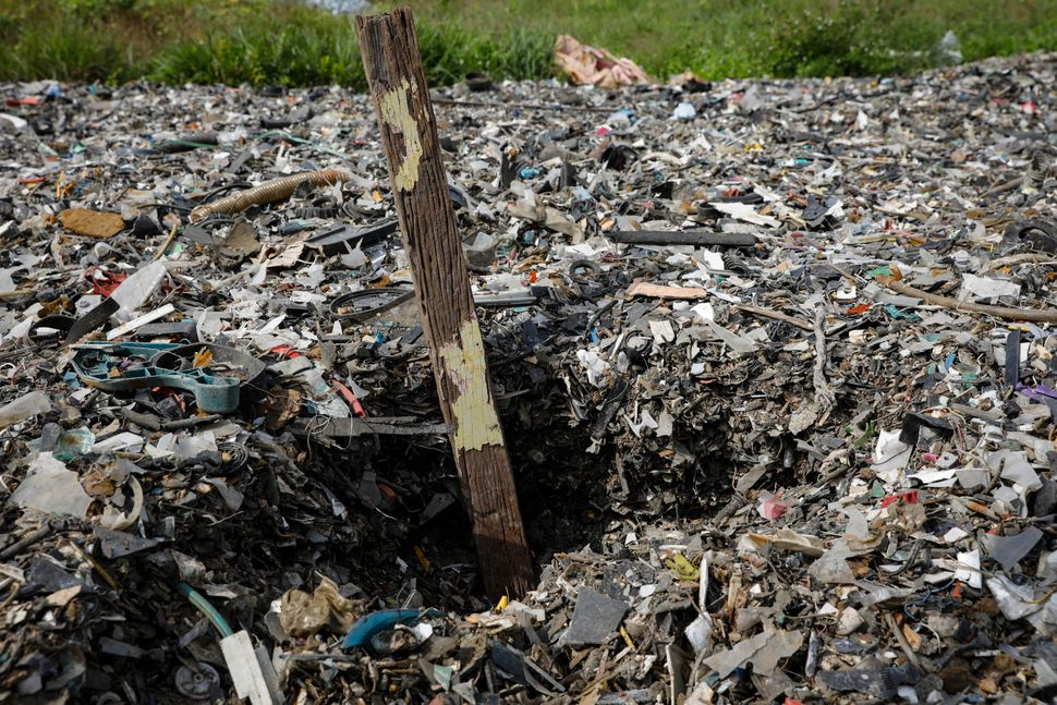 Plastics piles up at an illegal dumping site inside a palm oil estate in Kuala Langat on Feb. 2,