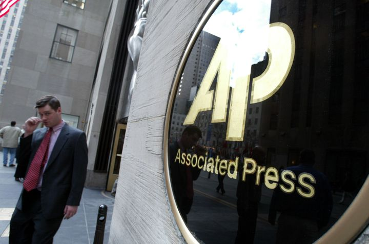 NEW YORK - JANUARY 9:  A man walks out of Associated Press (AP) headquarters January 9, 2003 in New York City. Because of a c