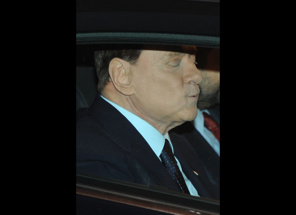 Italian Prime Minister Silvio Berlusconi leaves his residence in Rome, Palazzo Grazzioli, on November 13, 2011, the day after