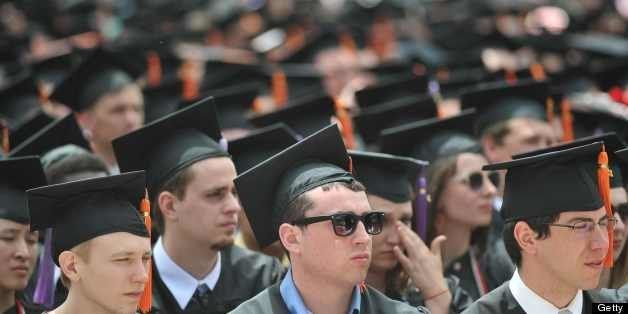 Graduating students are seen during the commencement ceremony at Ohio State University on May 5, 2013 in Columbus, Ohio. US P