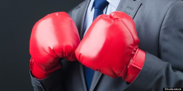 young businessman with boxing...