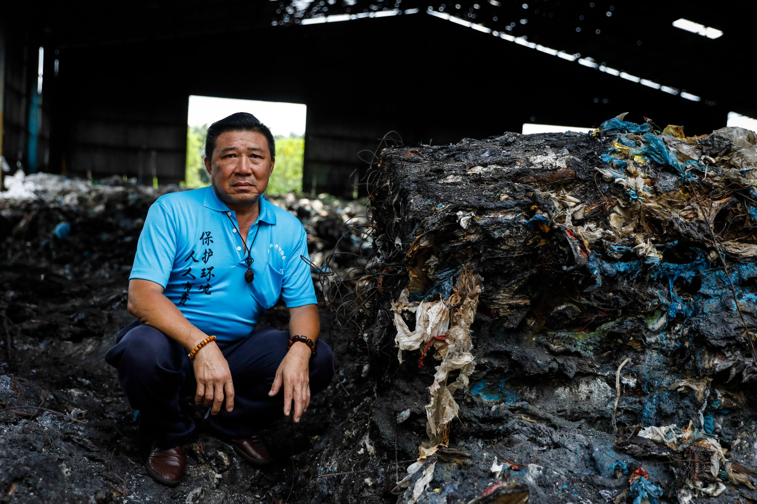 Tan, a volunteer, poses for a portrait at an illegal plastic recycling factory in Kuala Langat.