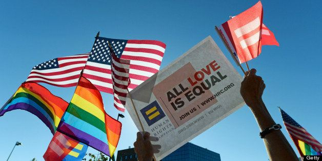 WEST HOLLYWOOD, CA - JUNE 26:  Same-sex marriage supporters celebrate the US Supreme Court ruling during a community rally on