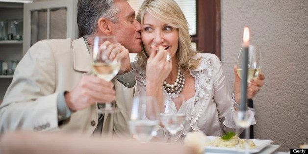 Couple kissing at table in restaurant