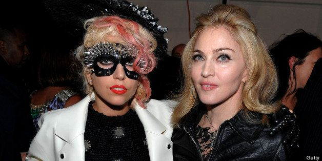 NEW YORK - SEPTEMBER 14:  Singer Lady Gaga and Madonna attend the Marc Jacobs 2010 Spring Fashion Show at the NY State Armory