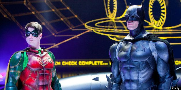LOS ANGELES, CA - SEPTEMBER 27:  Actors Lee Matthews (L) and Jack Walker pose on stage in costume as Robin and Batman during