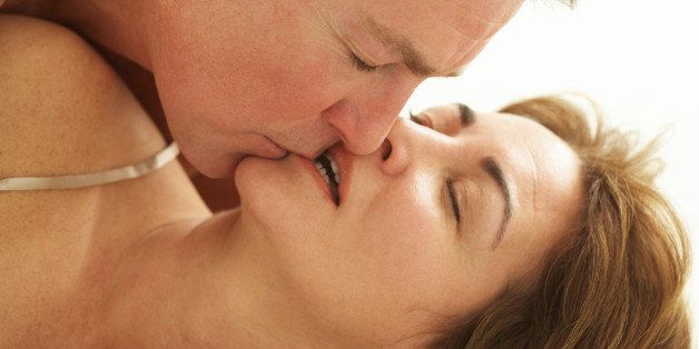 Mature man kissing woman, close-up