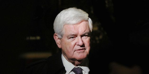 Former House of Representatives Speaker Newt Gingrich speaks to the media as he departs after a meeting with U.S. President-e