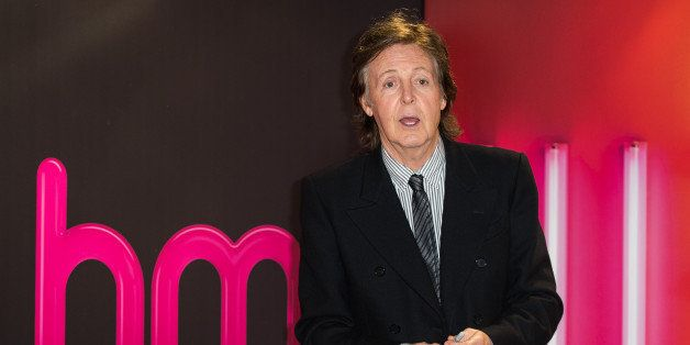 LONDON, ENGLAND - OCTOBER 18:  Paul McCartney meets fans and signs copies of his album 'New' at HMV, Oxford Street on October