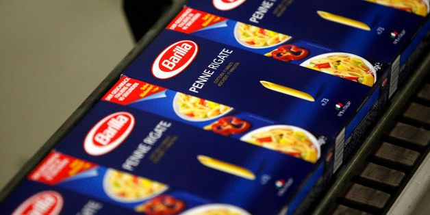 Boxes of packaged penne rigate pasta travel along the production line inside Barilla Holding SpA's factory in Parma, Italy, o