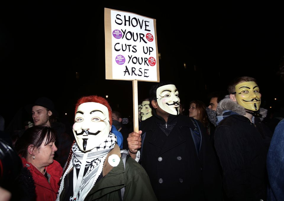 Protesters demonstrate as part of the Bonfire of Austerity protest outside the Houses of Parliament in central London.
