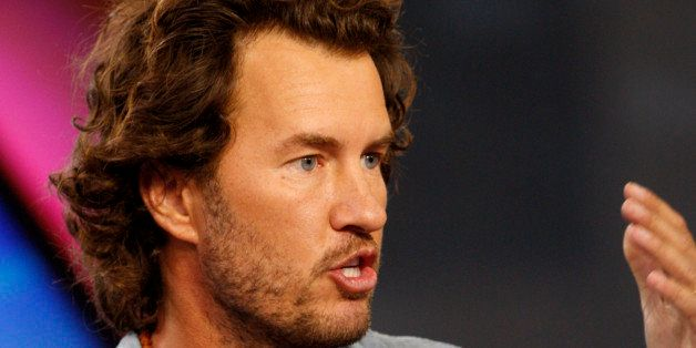 Blake Mycoskie, chief executive officer of TOMS Shoes Inc., speaks during a Bloomberg Television interview in New York, U.S.,