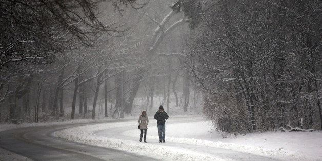 NEW YORK, NY - MARCH 08: People walk through a snow-shrouded park on March 8, 2013 in the Brooklyn borough of New York City.