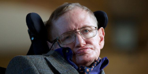 Theoretical physicist Stephen Hawking poses for a picture ahead of a gala screening of the documentary 'Hawking', a film abou