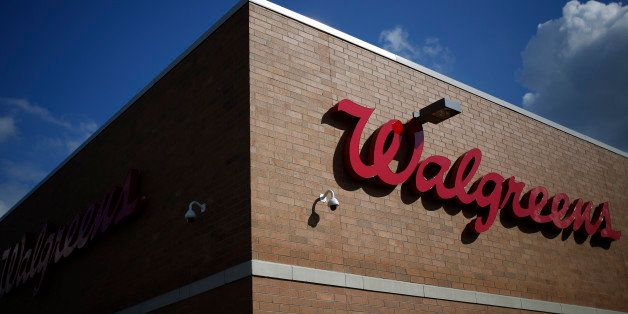 Walgreen Co. signage is displayed outside one of the company's stores in Louisville, Kentucky, U.S., on Monday, Sept. 30, 201