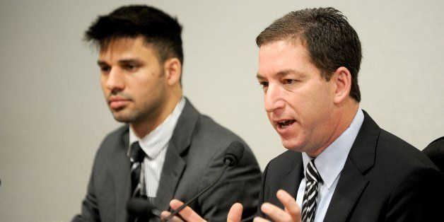 The Guardian's Brazil-based reporter Glenn Greenwald (R), who was among the first to reveal Washington's vast electronic surv