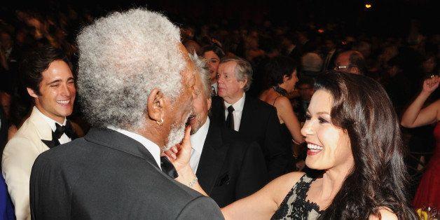 HOLLYWOOD, CA - JUNE 06:  (L-R) Actors Morgan Freeman and Catherine Zeta-Jones attend the 2014 AFI Life Achievement Award: A