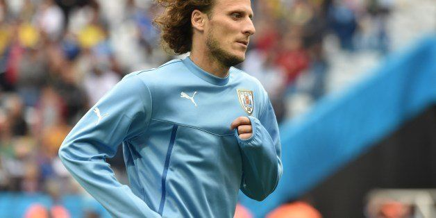 Uruguay's forward Diego Forlan warms up before the start of a Group D football match between Uruguay and England at the Corin