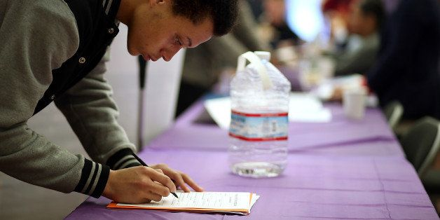 SAN FRANCISCO, CA - MAY 21:  A job seeker fills out an application during a career fair at the Southeast Community Facility C