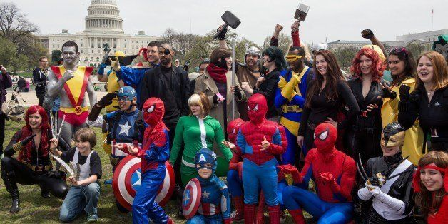 People dressed in superhero-style costumes line up for a photo near the US Capitol in  Washington, DC on April 18, 2014, in a