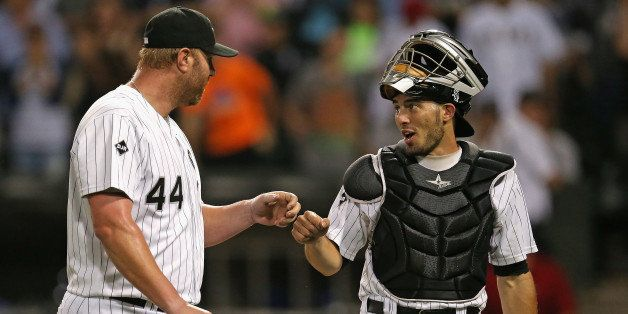 CHICAGO, IL - AUGUST 05:  Adam Dunn #44 of the Chicago White Sox is congratulated by Adrian Nieto #17 after pitching in the 9