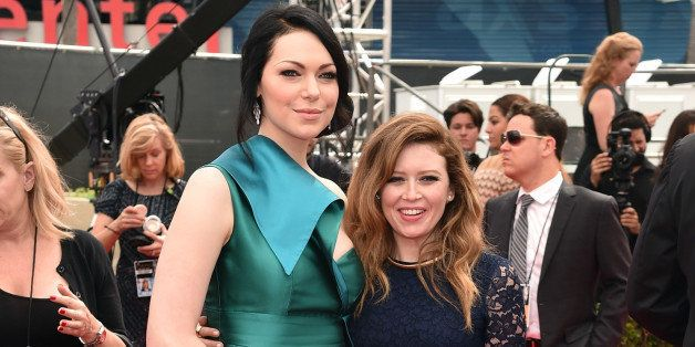 LOS ANGELES, CA - AUGUST 25:  Actresses Laura Prepon (L) and Natasha Lyonne attend the 66th Annual Primetime Emmy Awards held