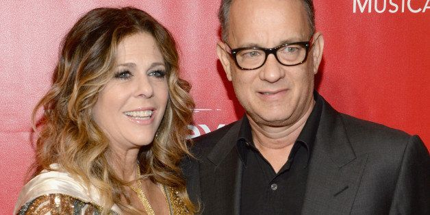 LOS ANGELES, CA - JANUARY 24:  Actors Rita Wilson (L) and Tom Hanks attend 2014 MusiCares Person Of The Year Honoring Carole