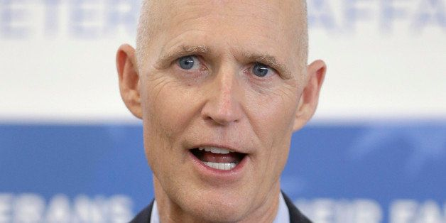 FILE- In this April 29, 2014 file photo, Florida Gov. Rick Scott speaks to members of the media after a ceremony during which