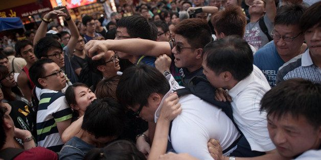 HONG KONG - OCTOBER 03:  Anti-Occupy supporters clash with Occupy camp members in Causeway Bay on October 3, 2014 in Hong Kon