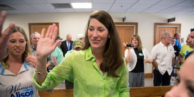 FILE - This July 30, 2014, file photo shows U.S. Senate candidate and Kentucky Secretary of State Alison Lundergan Grimes, as