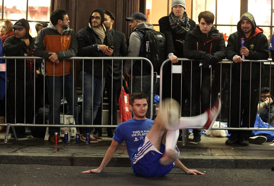 LONDON, ENGLAND - NOVEMBER 28:  A footballer entertains the queue of gaming fans in Covent Garden ahead of the launch of the