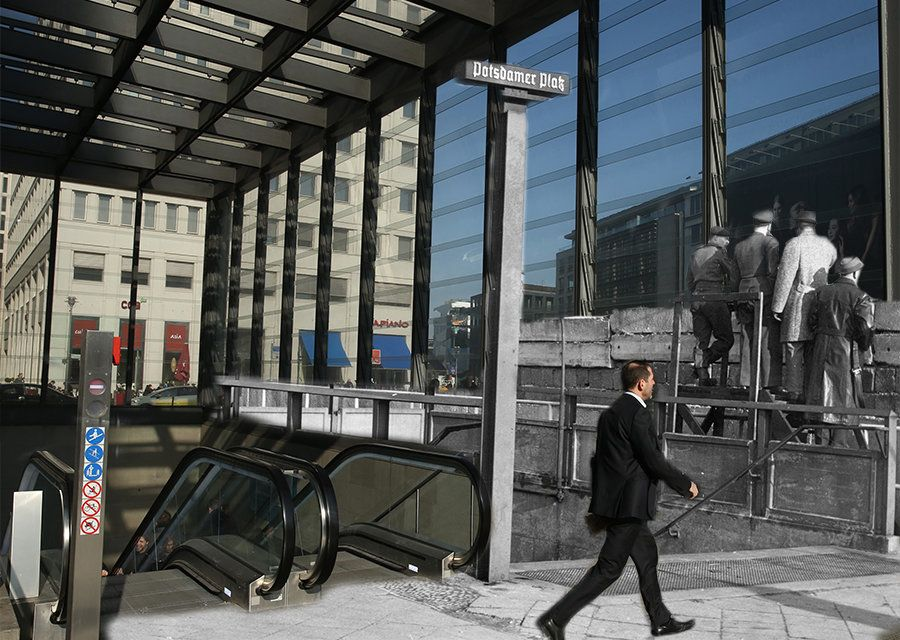 A man walks past the underground subway entrance at Potsdamer Platz on February 25, 2014 in Berlin, Germany. In black and whi