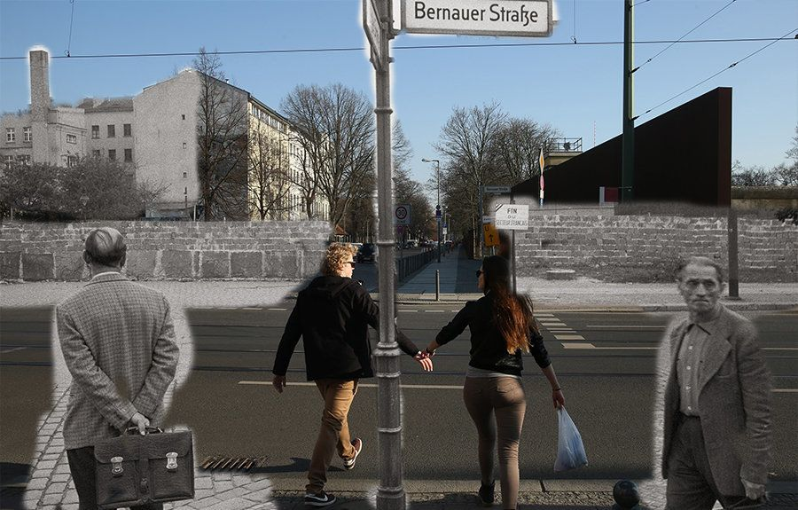 A couple crosses the street near the Berlin Wall memorial (R) at Bernauer Strasse on February 25, 2014 in Berlin, Germany. In