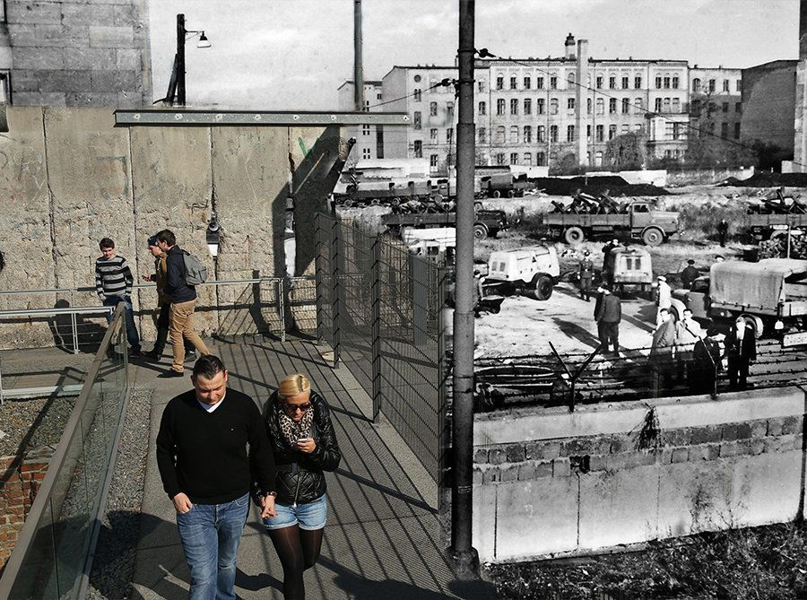 In the colour photo above, visitors walk next to a still-standing portion of the former Berlin Wall at the Topographies des T