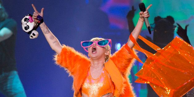 U.S. singer Miley Cyrus performs in concert during her Bangerz Tour in Mexico City, Friday, Sept. 19, 2014.  (AP Photo/Eduard