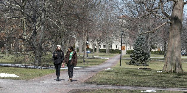 Two students walk on the campus of Oberlin College Tuesday, March 5, 2013, in Oberlin, Ohio.     Oberlin College  says it can