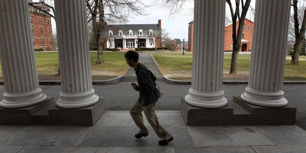 MEDFORD, MA - MARCH 25: A student runs across the Tufts University campus. (Photo by David L. Ryan/The Boston Globe via Getty