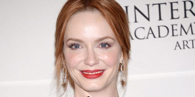 Actress Christina Hendricks poses in the International Emmy Awards press room at the New York Hilton on Monday, Nov. 24, 2014