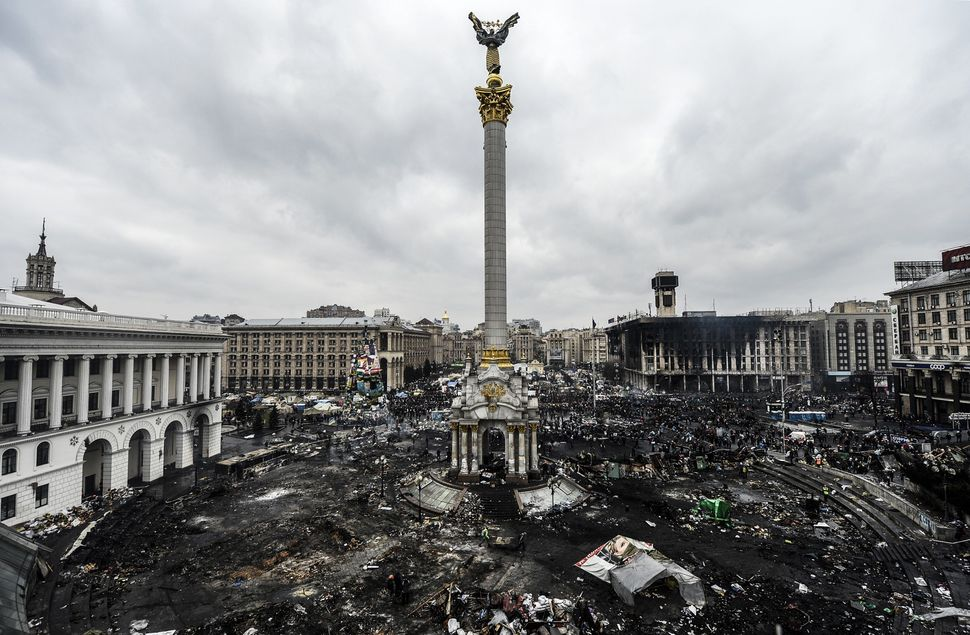 Ukrainian security forces violently clear out protest camps set up in the capital.