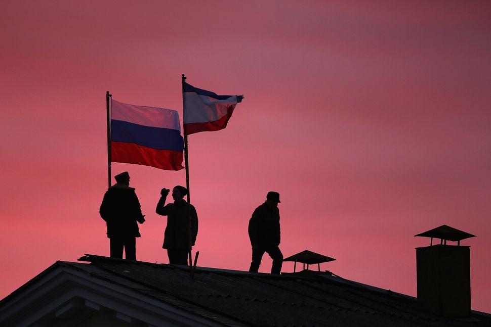 "Russia <a href=""http://www.cbsnews.com/news/russia-annexes-crimea-away-from-ukraine-with-signature-from-vladimir-putin/"" targ"